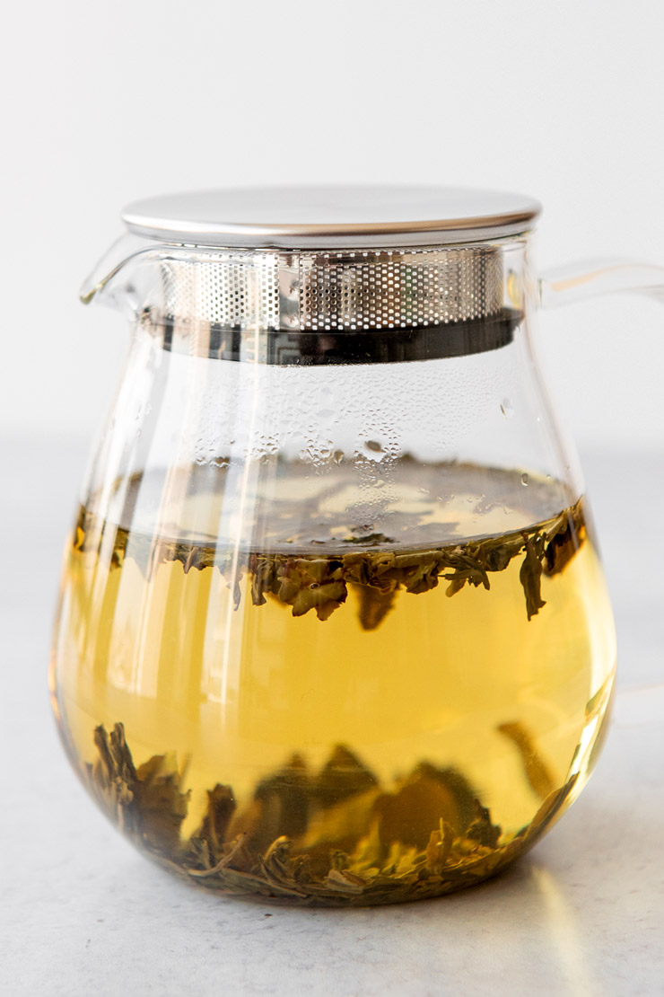 Cold steeping loose tea in a glass teapot.