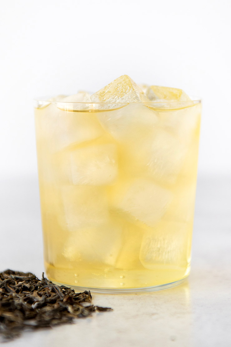 Cold brew jasmine tea in cup with ice