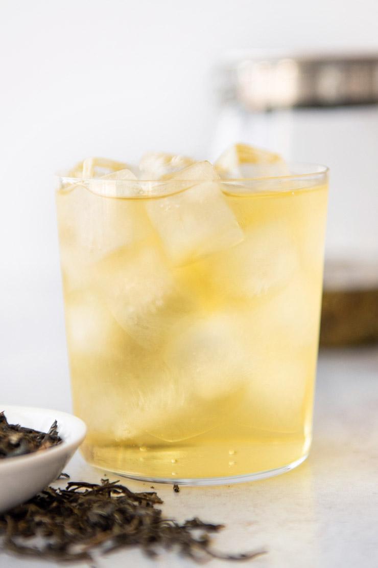 Iced jasmine tea in cup with ice