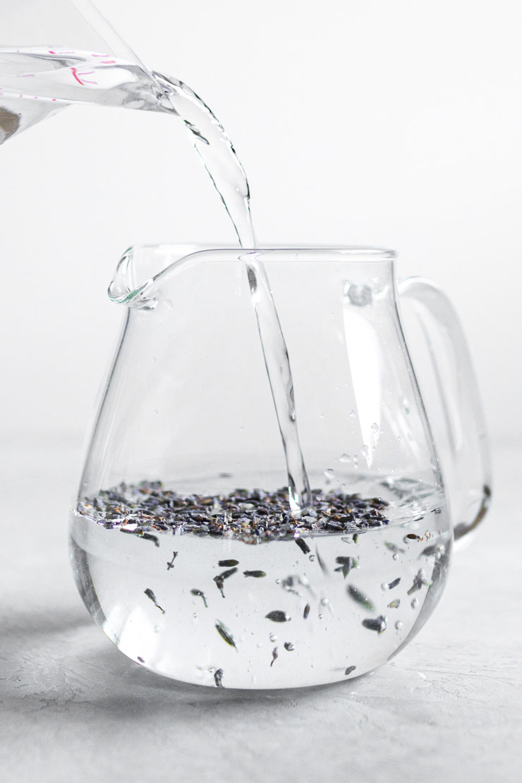 Water and lavender buds in teapot