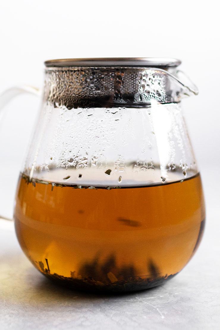 Peppermint tea in a glass teapot.