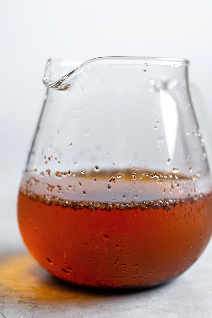 Cold brewed rooibos tea in a glass teapot.