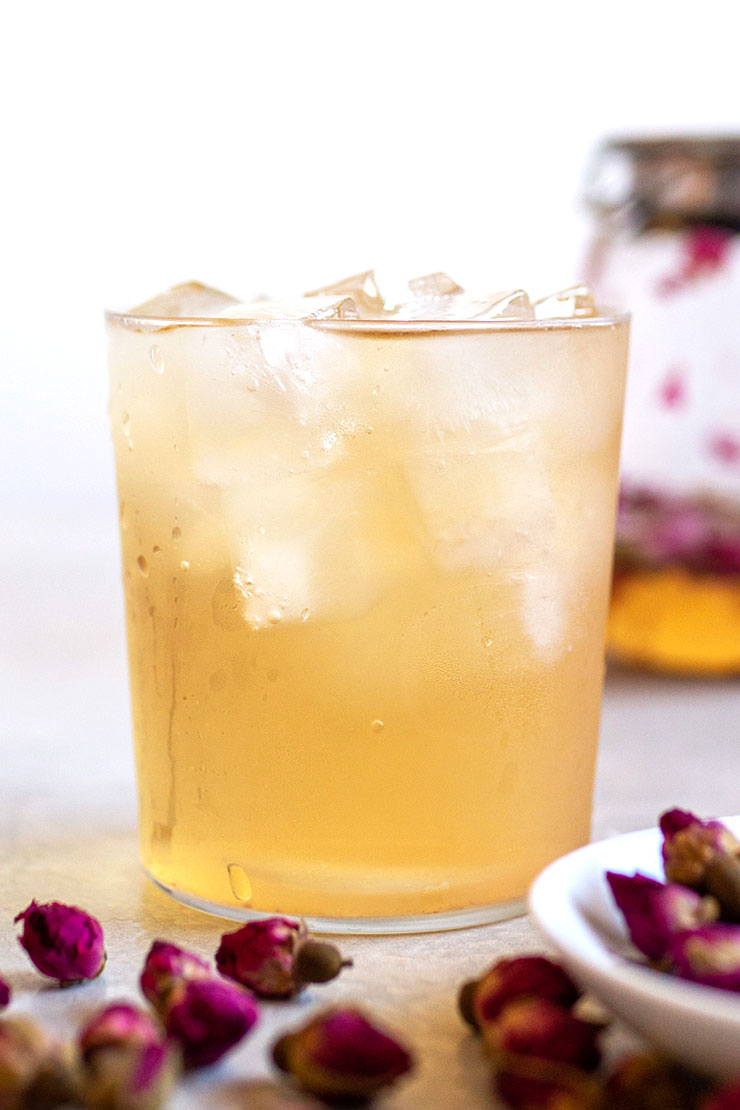 Iced rose tea in a glass cup with ice