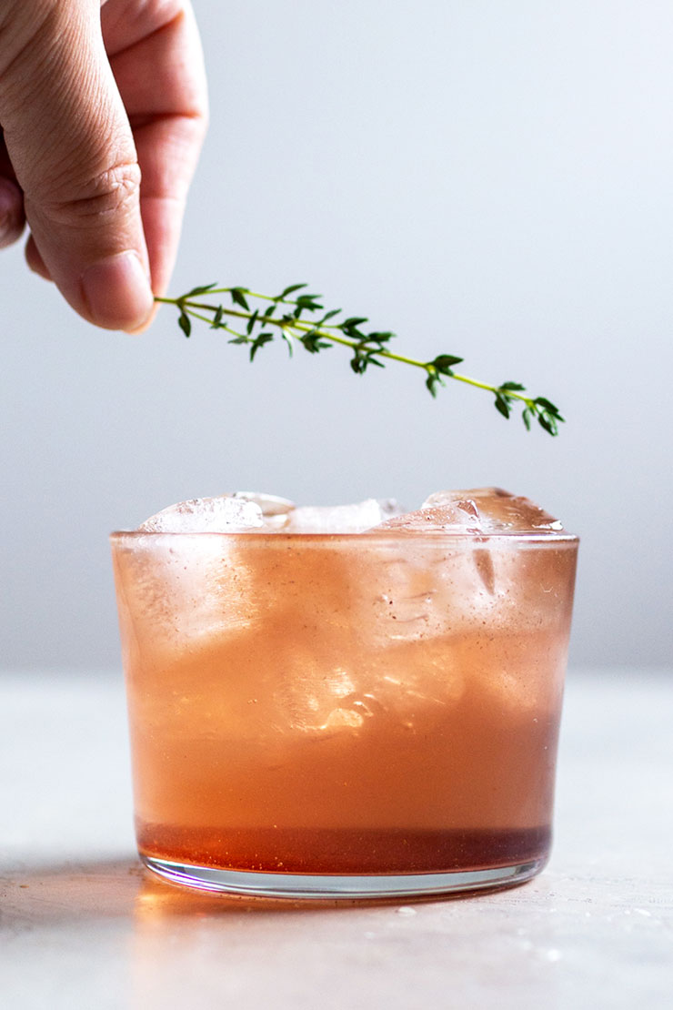 Thyme on sparkling hibiscus yerba mate drink