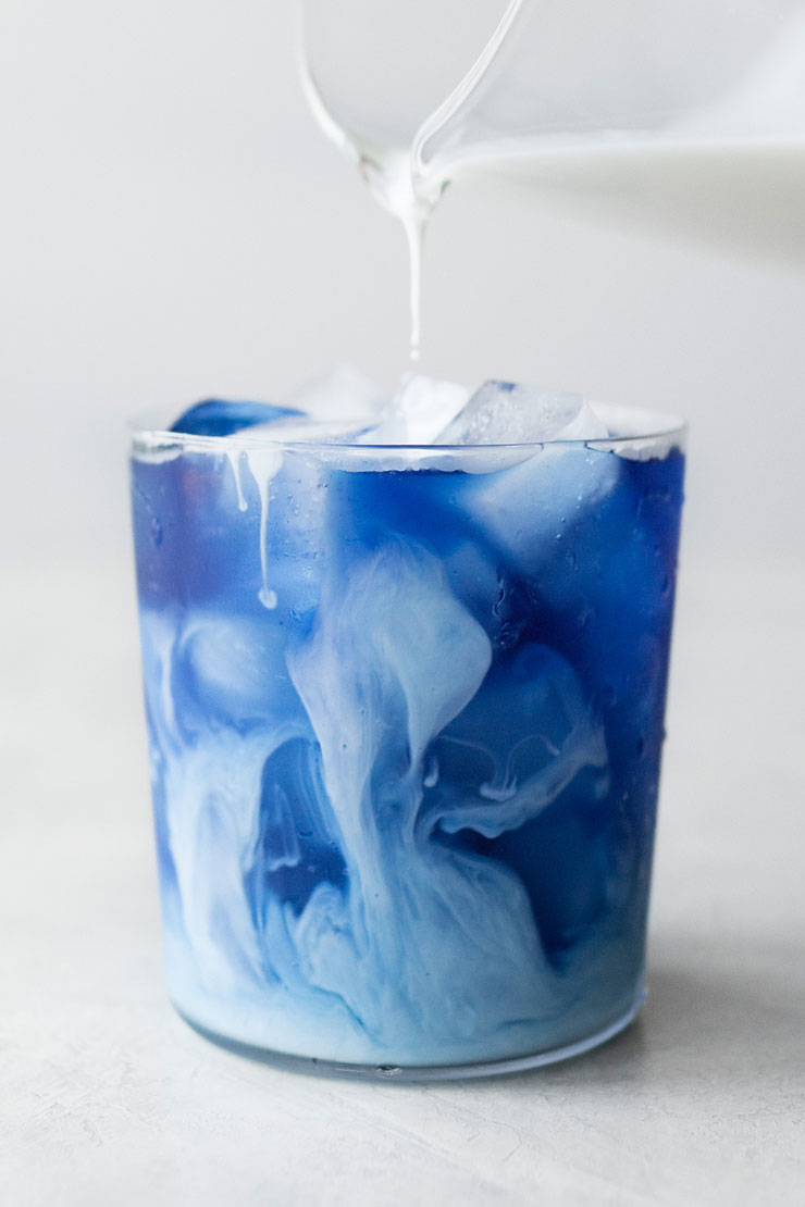 Blue tea in cup with half & half