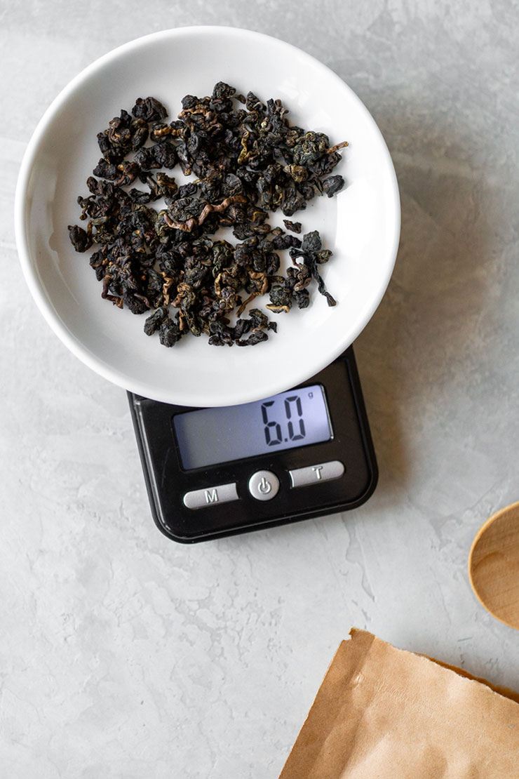 Weighing loose oolong tea on a scale