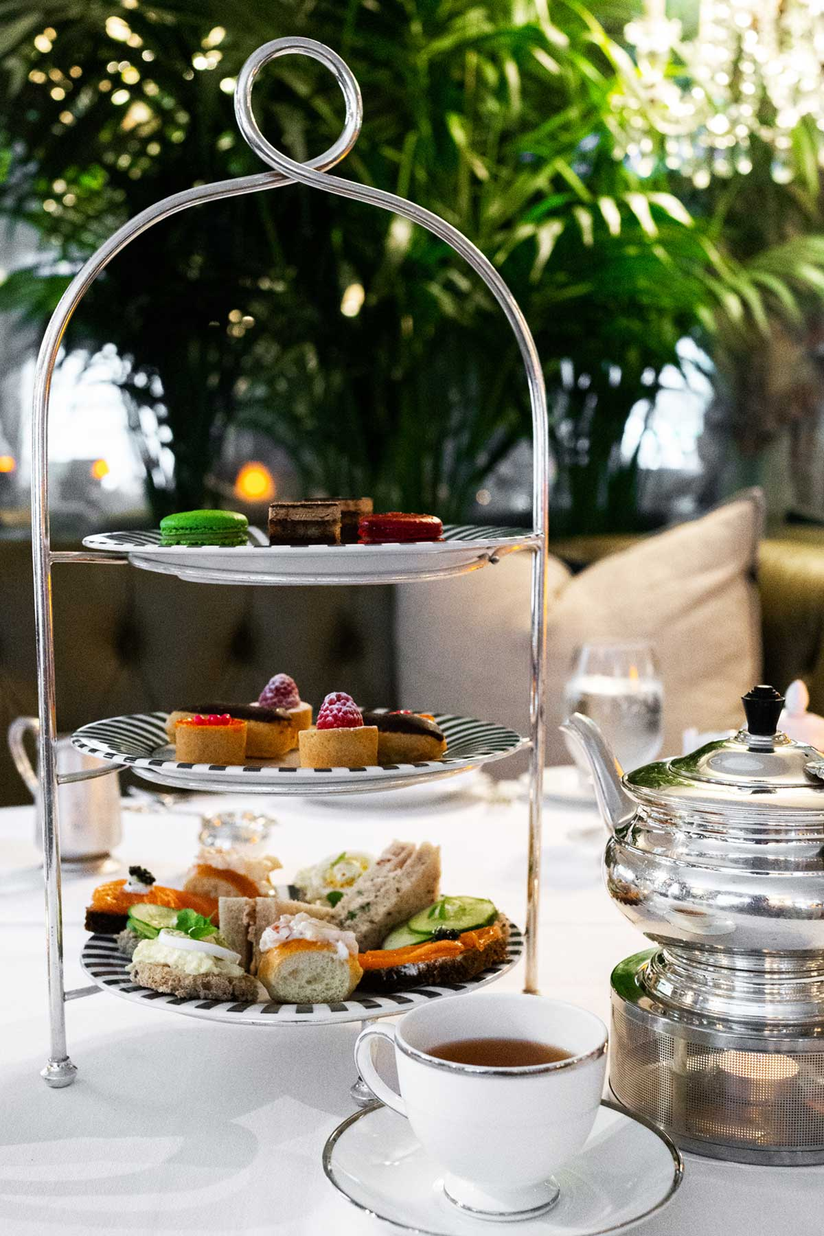 Three-tiered tray and tea on a table for afternoon tea.