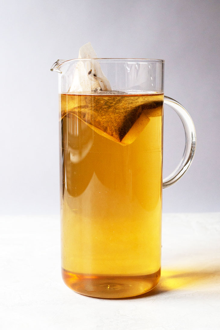Barley tea bag in pitcher with water.
