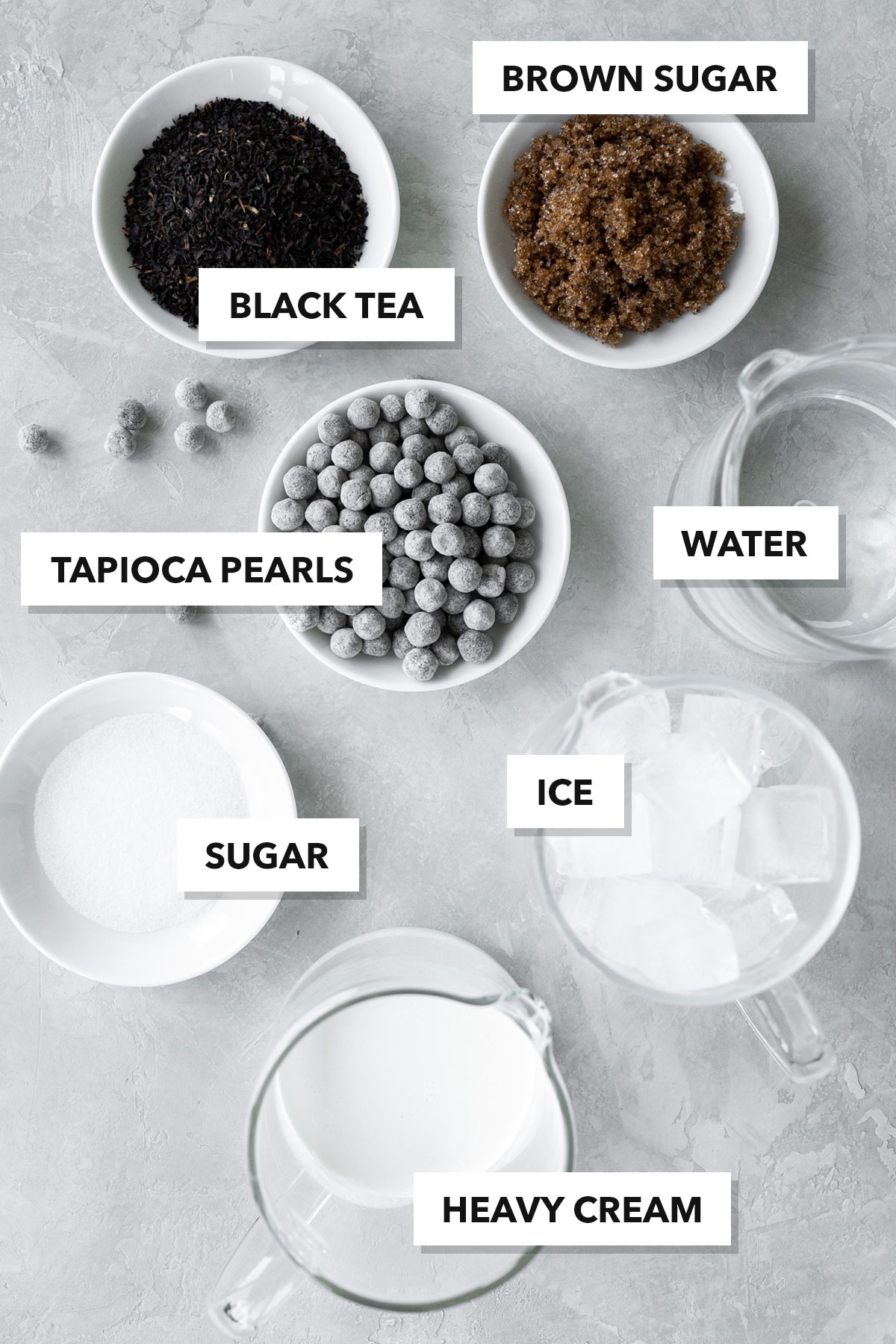 Bubble tea ingredients in individual plates and containers.