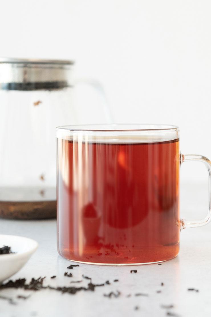 Hot Ceylon tea in a glass mug.