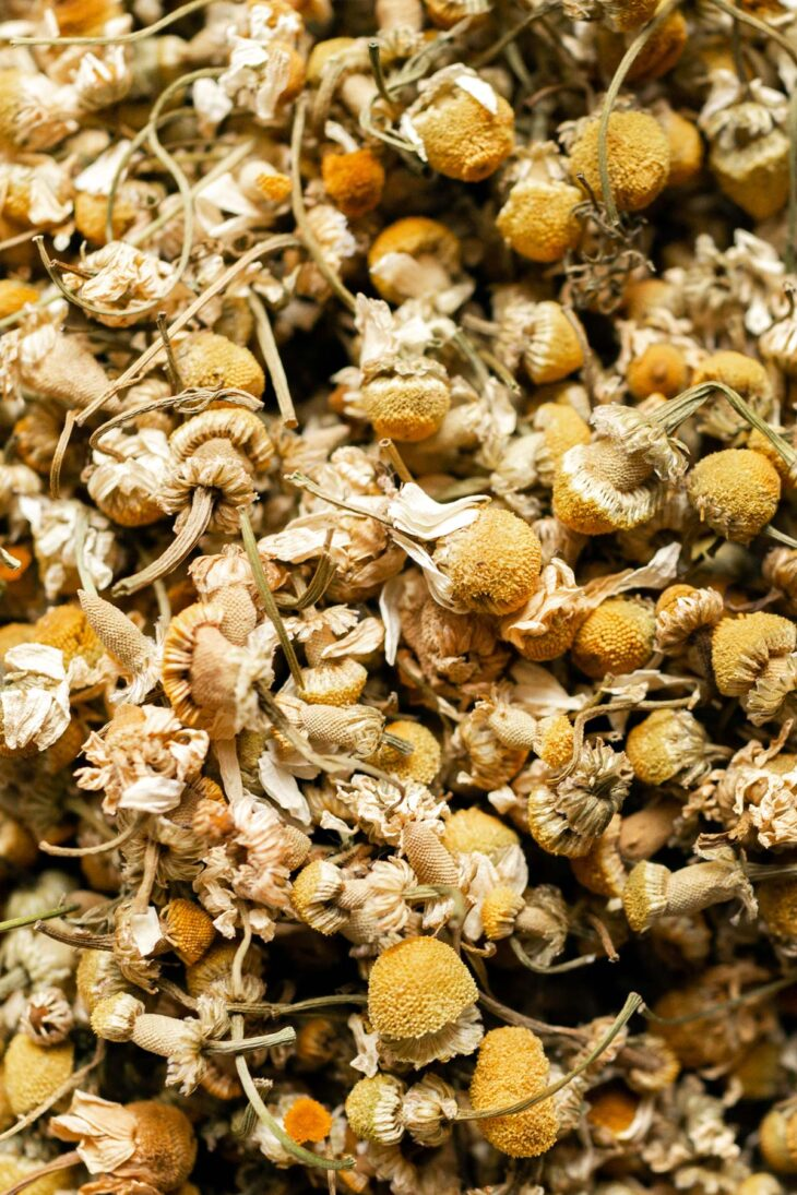 Loose, dried chamomile flowers.