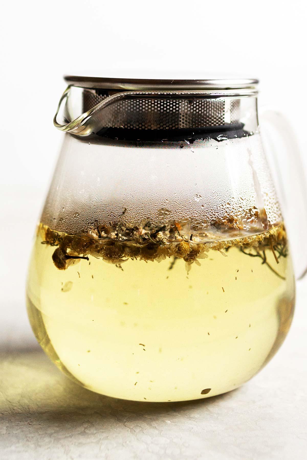 Chamomile tea steeping in a teapot.