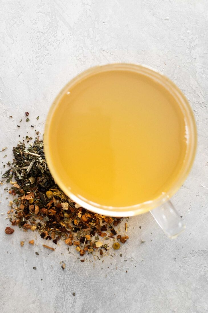 Glass of Starbucks Honey Citrus Mint Tea and loose tea next to it.