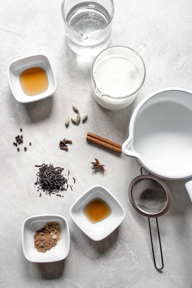 Chai latte ingredients on a surface.