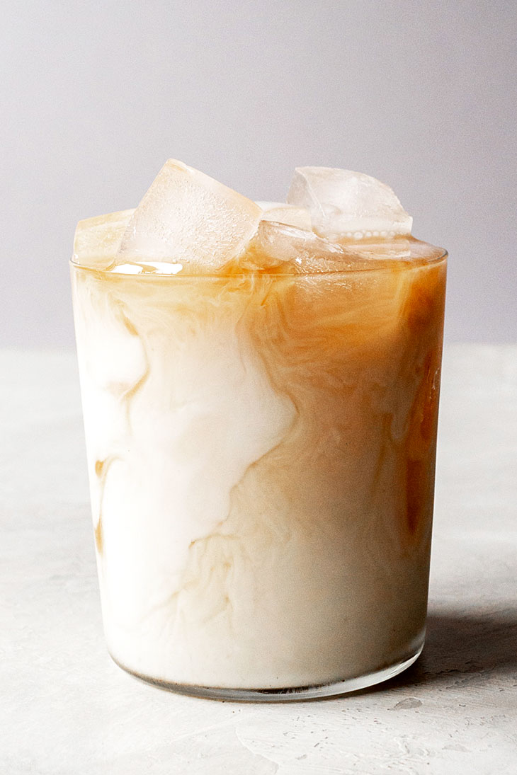 Chai latte in a cup with ice.