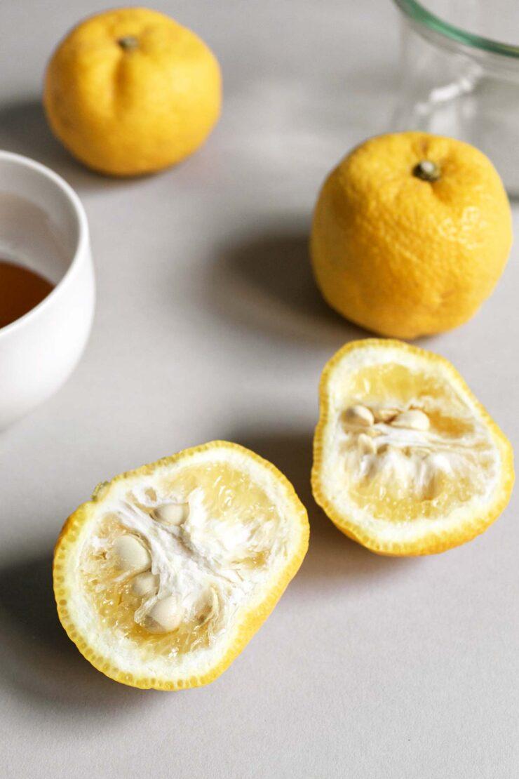 Yuzu fruit, cut in half.