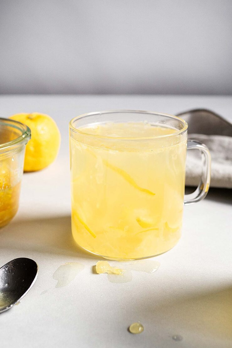 Honey Citron Tea in a glass mug.