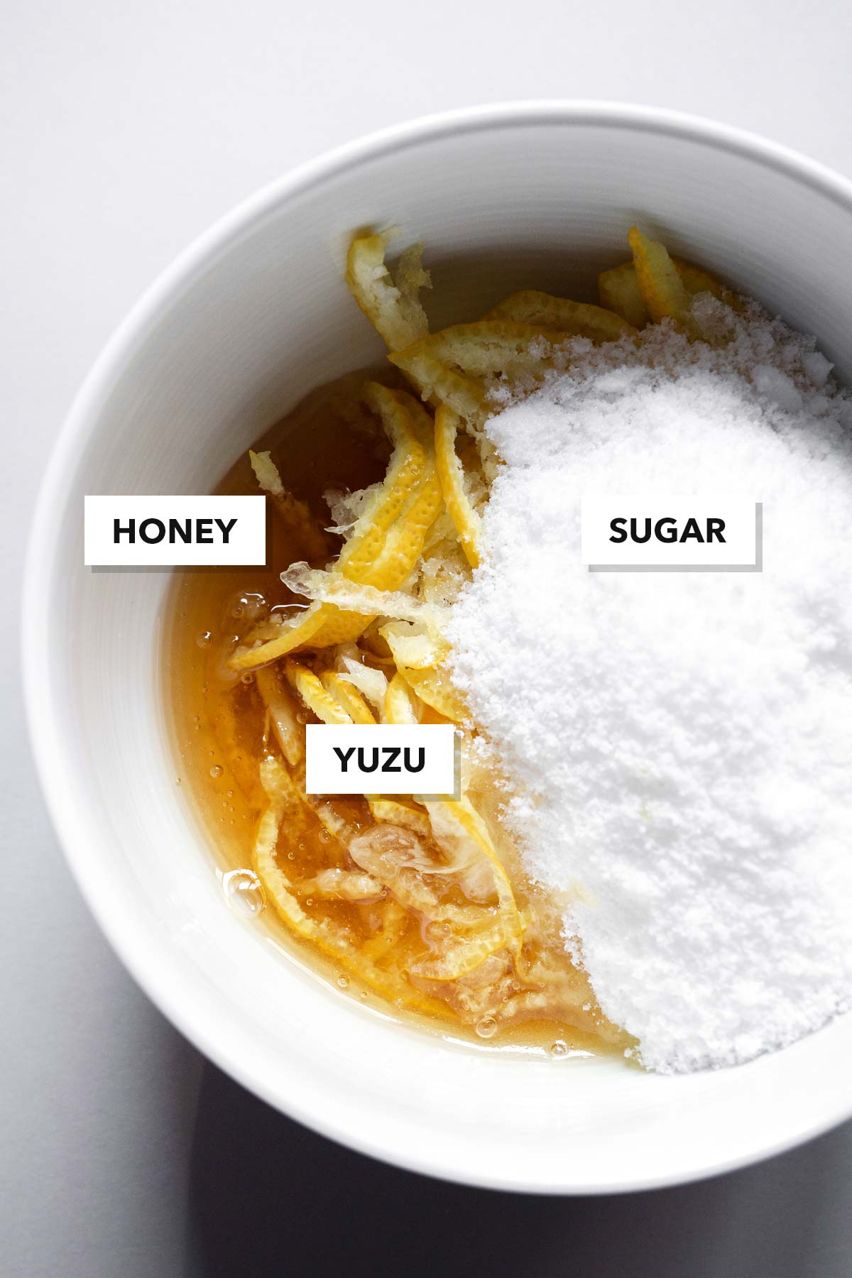 Honey citron tea ingredients in a bowl.