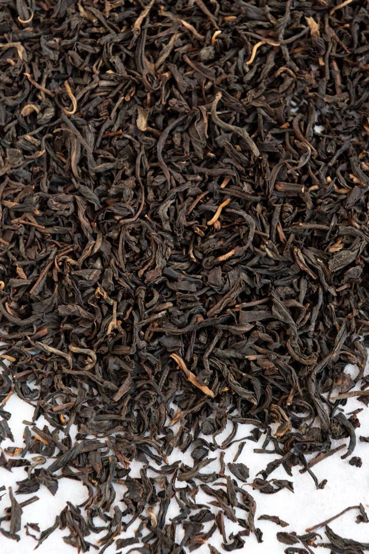 Loose lapsang souchong black tea.