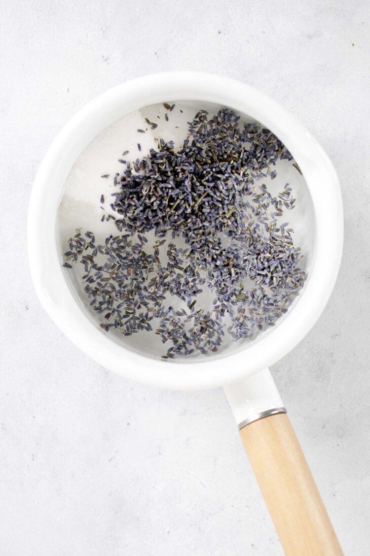 Lavender simple syrup ingredients in a saucepan.