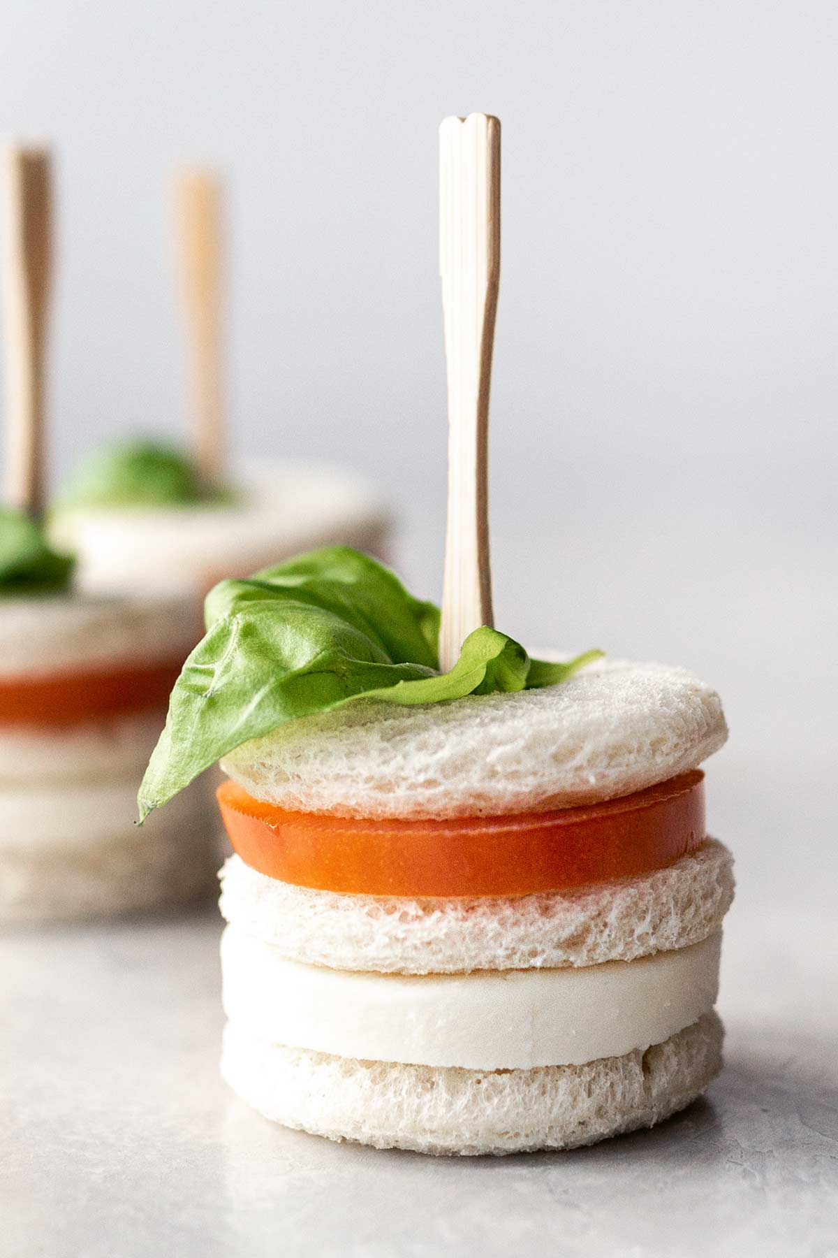 Mozzarella and tomato tea sandwiches with cocktail forks.