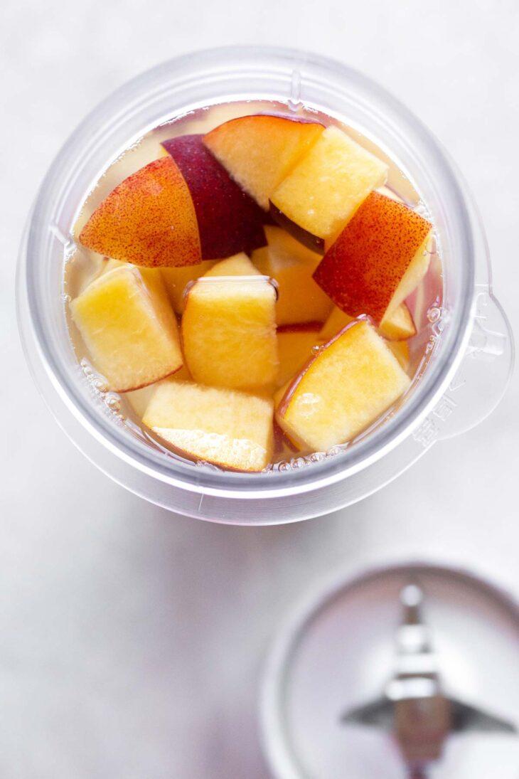 Diced peaches in a mini blender.