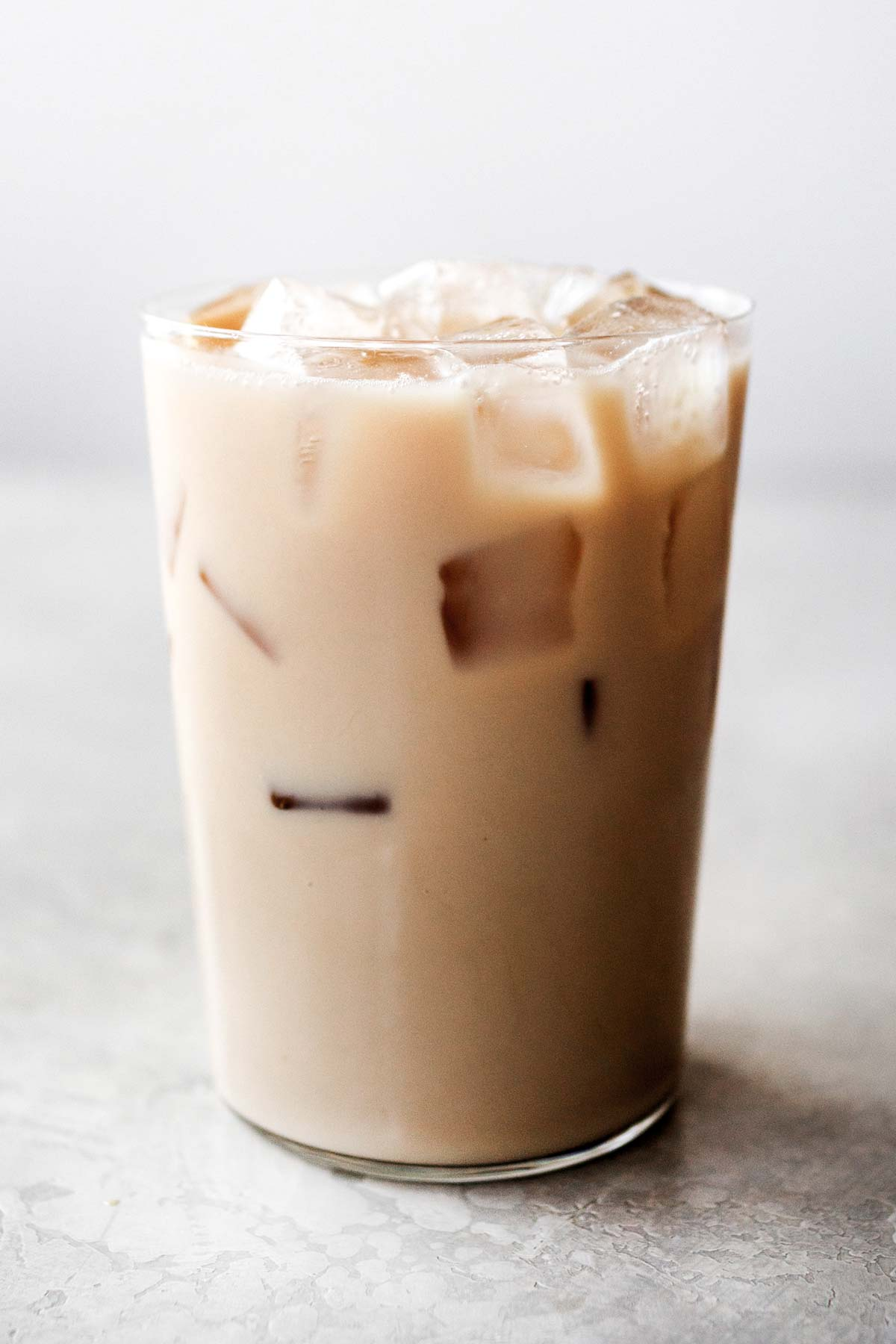 Starbucks Iced Chai Tea Latte dopycat drink in a glass cup.
