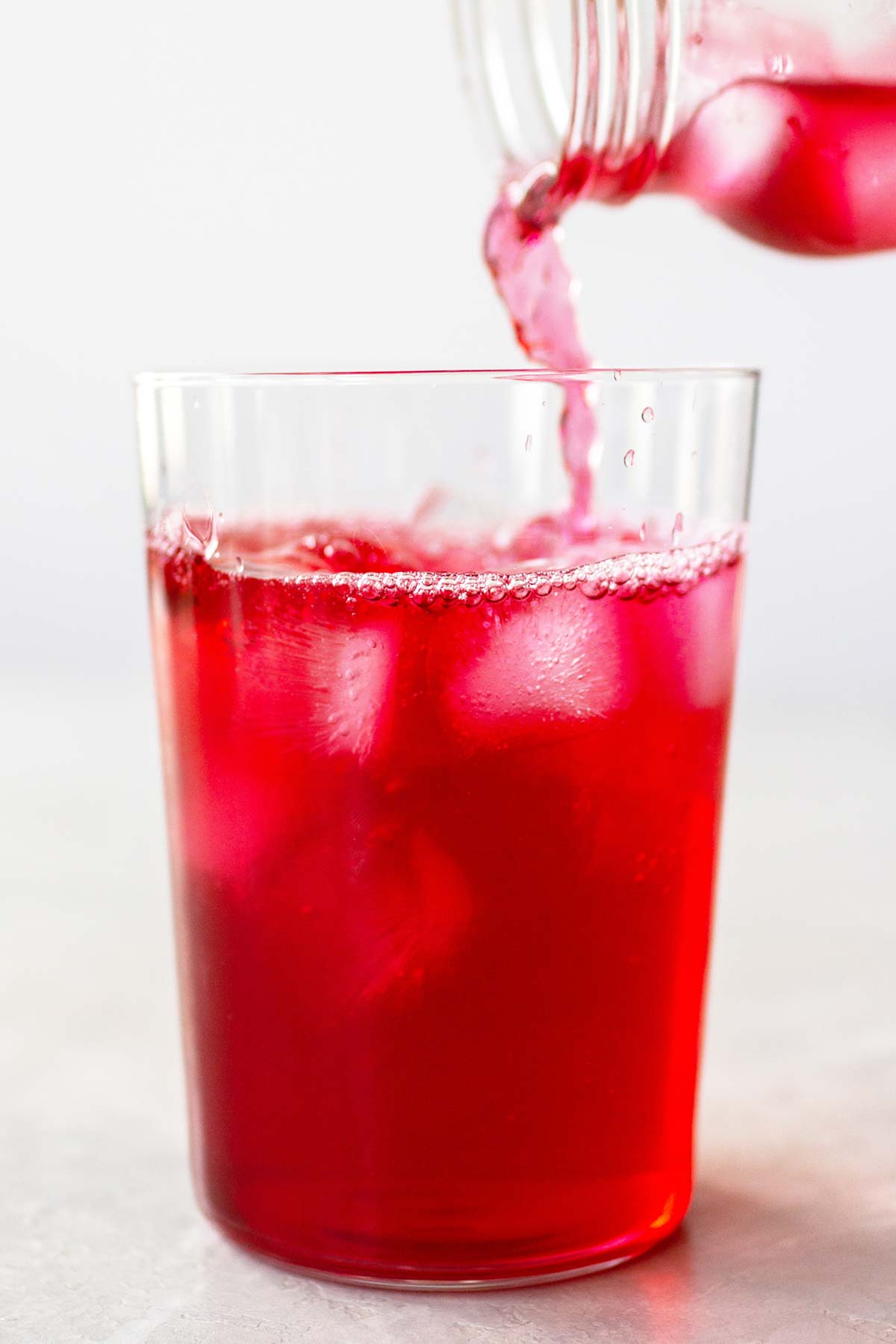 Pouring Iced Passion Tango Tea into a cup.