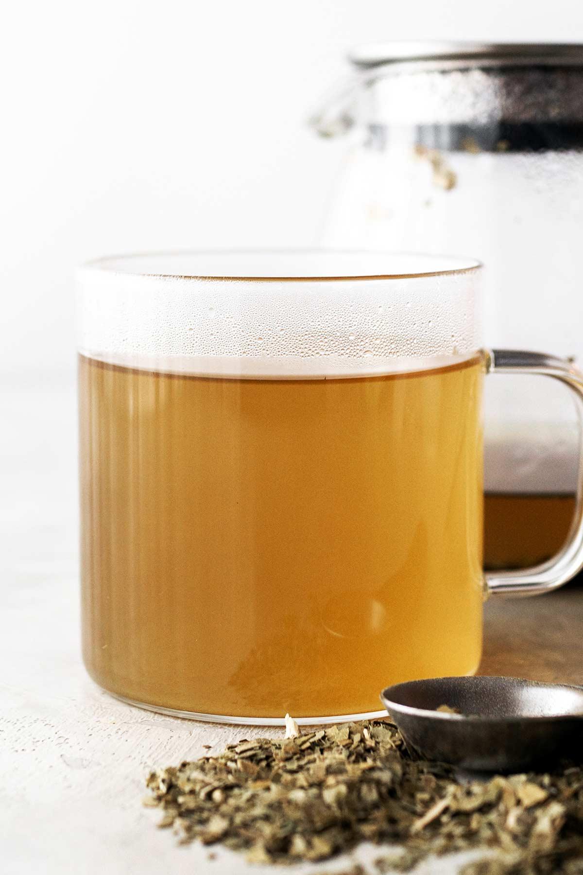 Hot yerba mate tea in a glass mug.